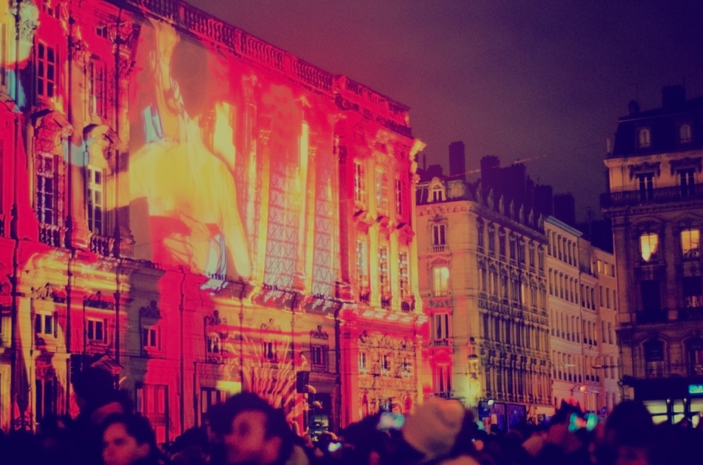 Place Des Terreaux alight with mixed animations and video