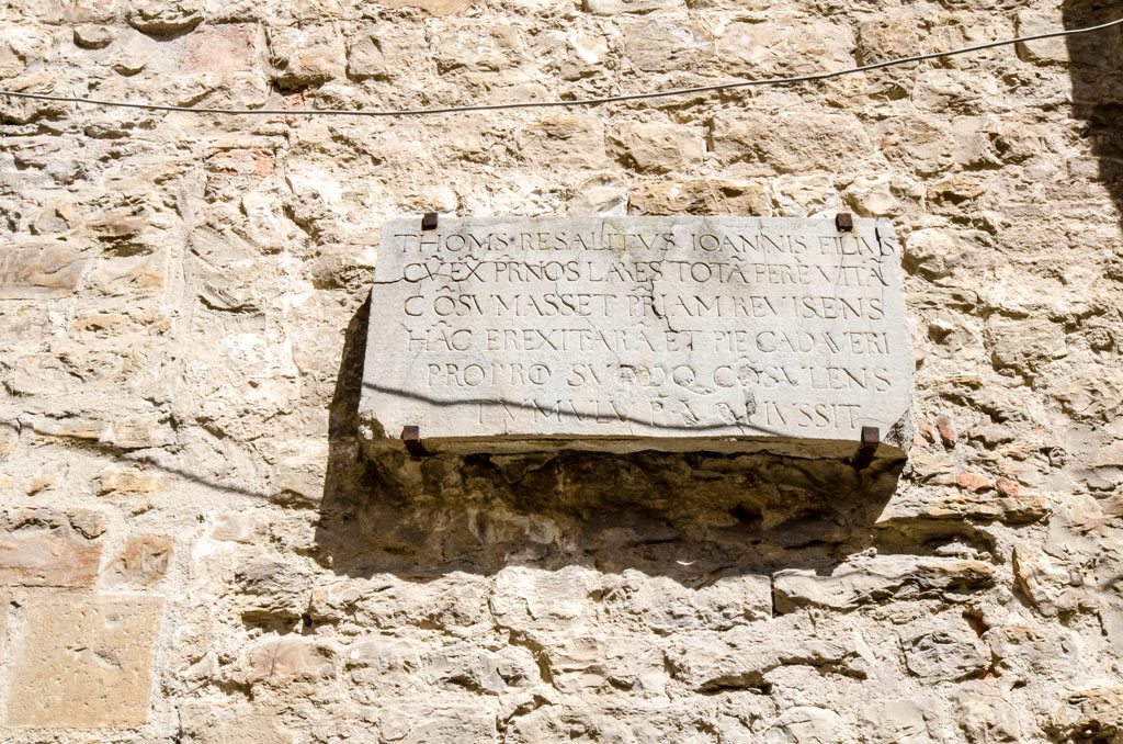 A stone plaque on an exterior wall Santa Croce