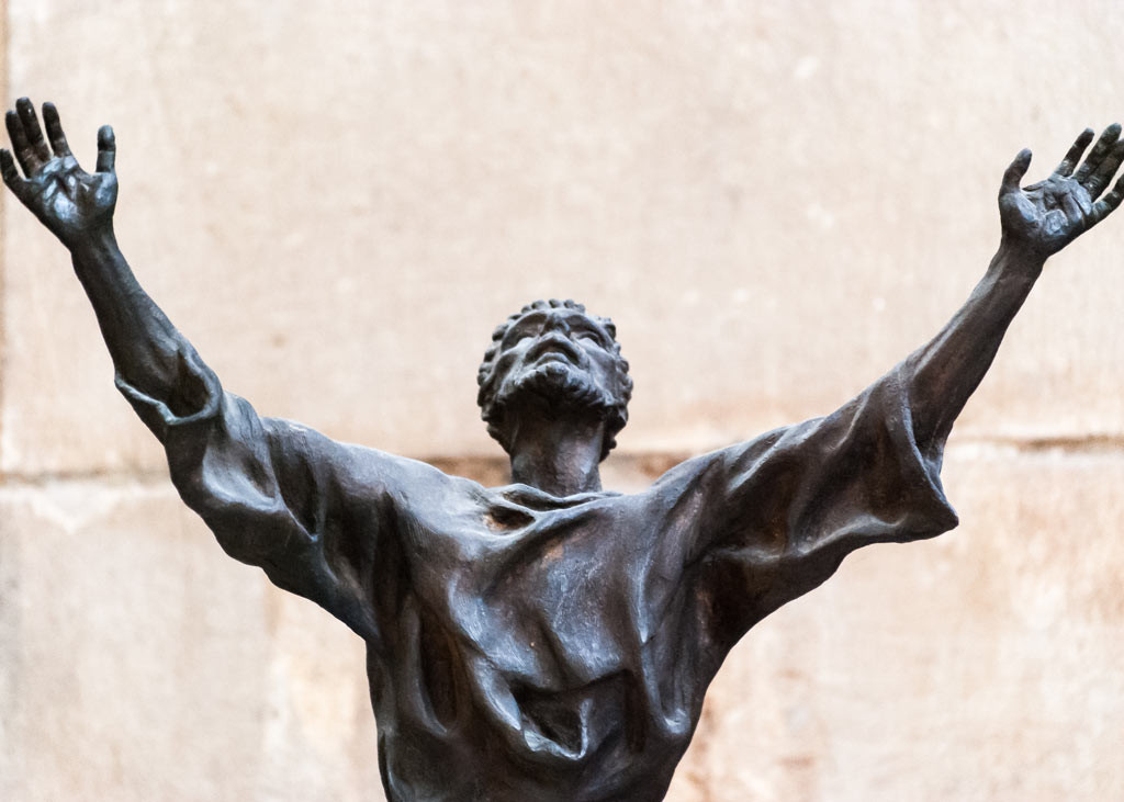 Bust of a man arms outstretched