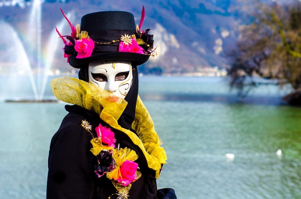 A lone masquerader by the lake in Annecy