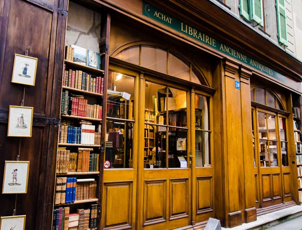 Antique bookstore with exterior shelves built into the facade