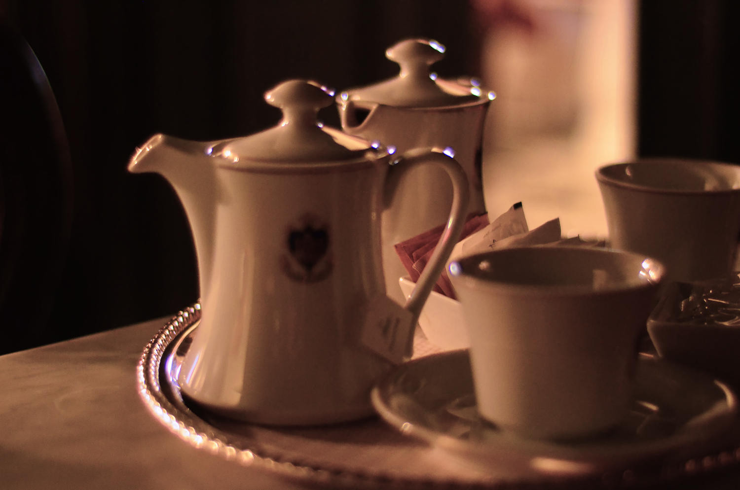 A tea pot, cups and tea in Florian Firenze