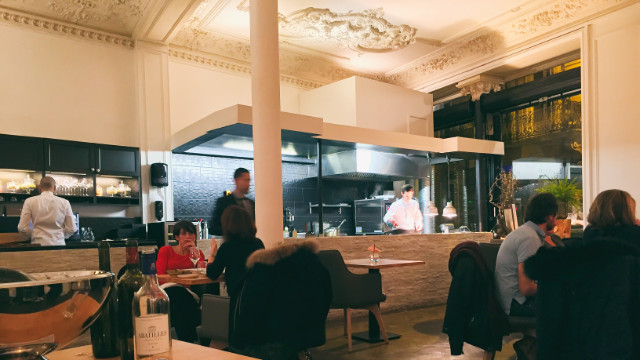 Interiors with open kitchen at the Cote Rue restaurant in Bordeaux